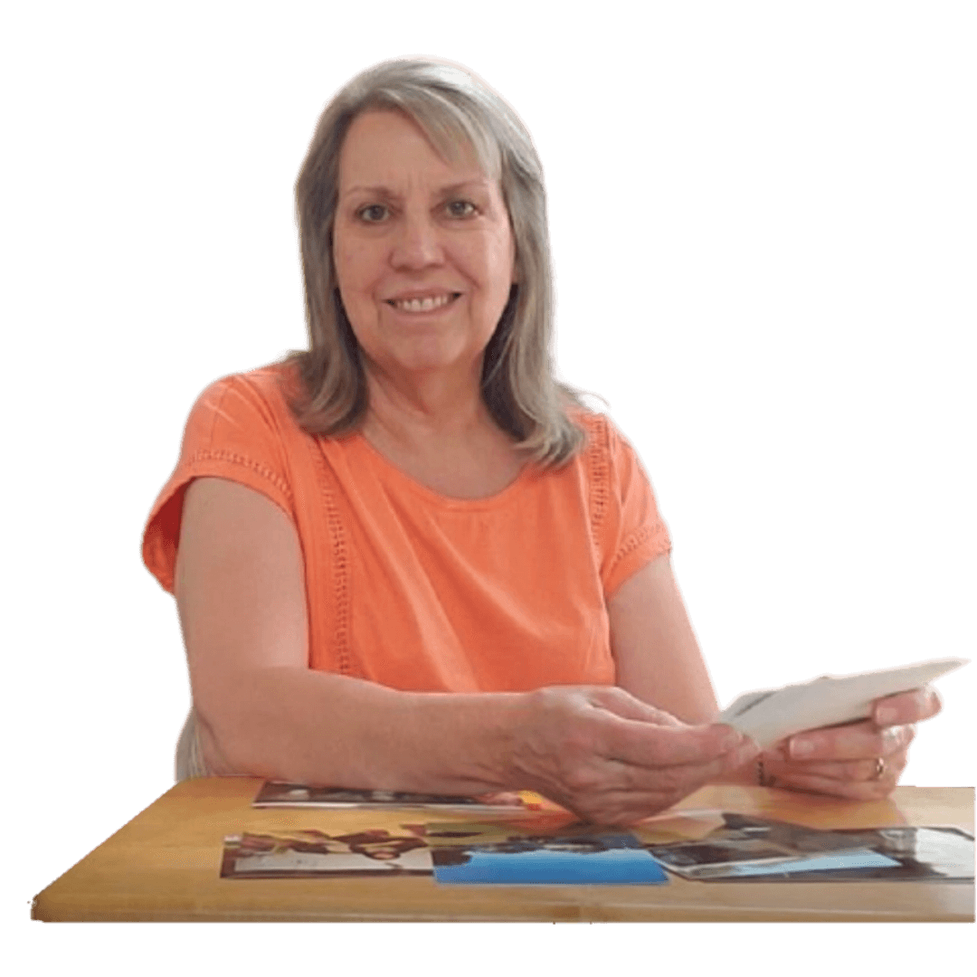 smiling mature woman holding photographs
