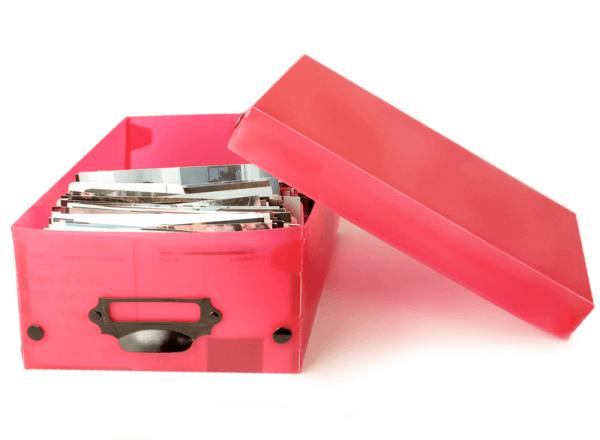 a red plastic box with organized photos inside